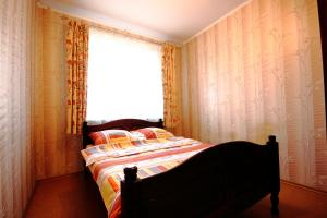 Кровать или кровати в номере Apartment on Lenina 48
