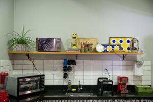 A kitchen or kitchenette at Um Hostel