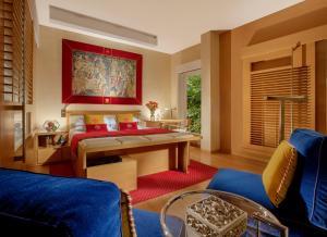 Ein Bett oder Betten in einem Zimmer der Unterkunft Bio Hotel Raphael - Relais & Châteaux