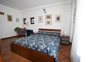 A bed or beds in a room at Villa sul Mare