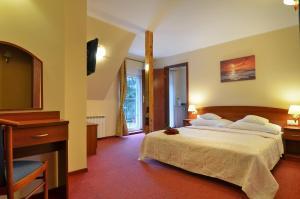 Łóżko lub łóżka w pokoju w obiekcie Morska Fala