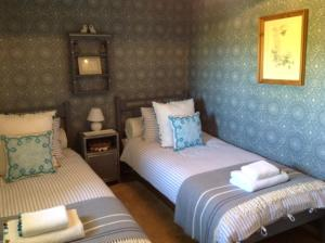 A bed or beds in a room at Chez Brown