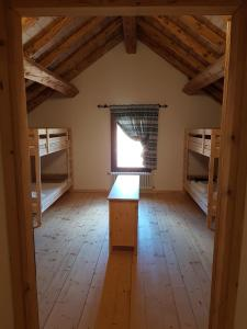 A bunk bed or bunk beds in a room at Malga Giau