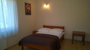 Łóżko lub łóżka w pokoju w obiekcie Kwatery Prywatne Margo