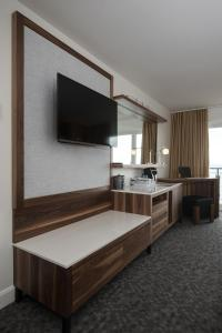 A television and/or entertainment center at Auberge de la Pointe