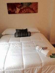 A bed or beds in a room at DC Gem
