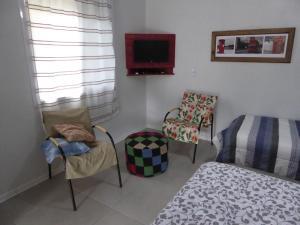 Uma área de estar em Villa Holística