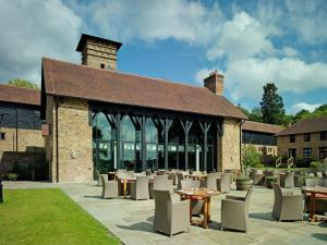 A restaurant or other place to eat at Coworth Park - Dorchester Collection