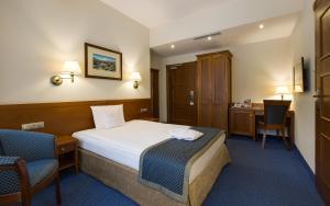 Łóżko lub łóżka w pokoju w obiekcie Bukowy Park Hotel Medical SPA