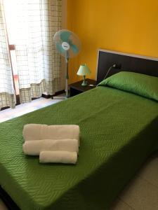 Кровать или кровати в номере Hotel Marina