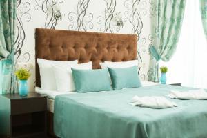 Кровать или кровати в номере Отель Грейс Кипарис