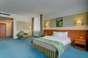 Кровать или кровати в номере Отель Бородино