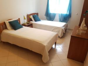 A bed or beds in a room at Apartamento Silva