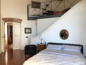 Letto o letti in una camera di B&B Palazzo Conforti