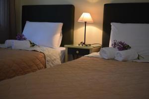 Letto o letti in una camera di Strophilia Apartments