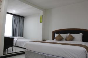 A bed or beds in a room at Hotel Bayt Kaboki