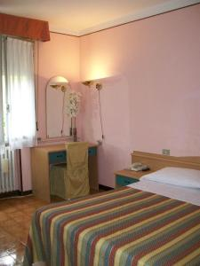 Кровать или кровати в номере Hotel La Rosta