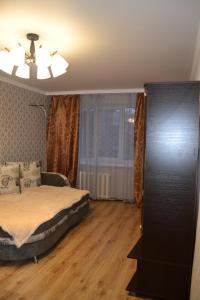 Кровать или кровати в номере Apartments at 45 Parallel