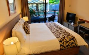 A bed or beds in a room at Quest Ascot