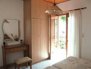A bed or beds in a room at Limenaria Apartments