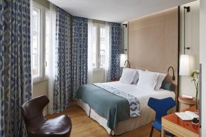 Cama ou camas em um quarto em Hôtel Bel Ami