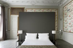A bed or beds in a room at Boutique Hotel Baudon de Mauny