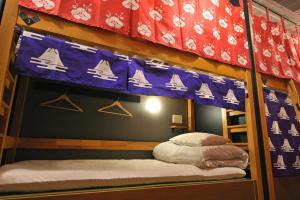 A bunk bed or bunk beds in a room at Khaosan World Tennoji