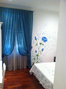 A bed or beds in a room at Affittacamere La Stazione