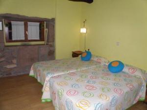 A bed or beds in a room at Posada Elbete
