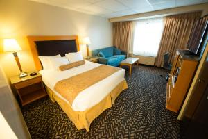 A bed or beds in a room at Prestige Prince Rupert