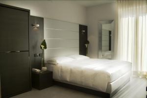 Кровать или кровати в номере Hotel San Lorenzo Chiavenna
