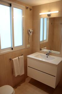 Un baño de Aparthotel Milord's Suites