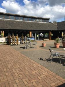 A restaurant or other place to eat at ibis Budget Warrington Lymm Services