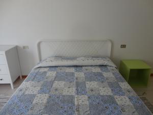 Letto o letti in una camera di Via Dante 10 Apartment