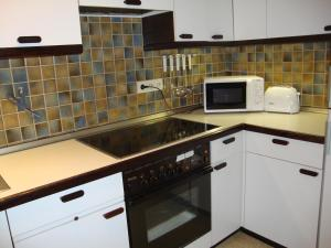 A kitchen or kitchenette at First Class Residence