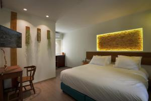 Un ou plusieurs lits dans un hébergement de l'établissement Locandiera