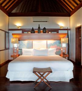 A bed or beds in a room at Sofitel Kia Ora Moorea Beach Resort