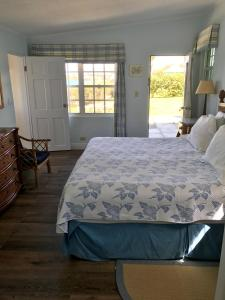 A bed or beds in a room at Greenbank Guest House