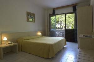 Postel nebo postele na pokoji v ubytování Hotel Santa Cruz