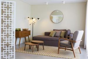 Uma área de estar em OZADI Tavira Hotel