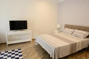 A bed or beds in a room at Fronte Del Porto
