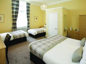 A bed or beds in a room at The Robin Hill