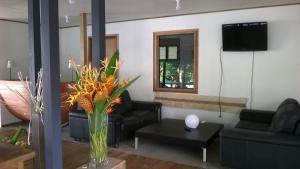 A seating area at Evis Resort at Nggatirana Island