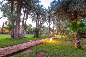 A garden outside Hôtel Farah Marrakech