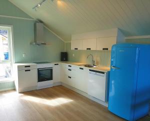 A kitchen or kitchenette at Saltstraumen Brygge