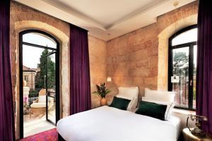 A bed or beds in a room at Villa Brown Jerusalem