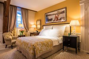 Ein Bett oder Betten in einem Zimmer der Unterkunft Grand Hotel du Lac