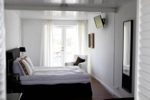 En eller flere senge i et værelse på Ilse Made - Hotellet ved Kilden