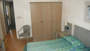 A bed or beds in a room at Comino Hotel