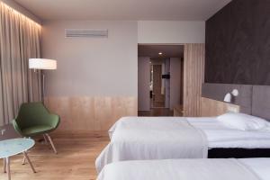 Ein Bett oder Betten in einem Zimmer der Unterkunft Hotel Tartu
